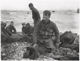 D Day Soldier Sitting Among Wounded on Omaha Beach